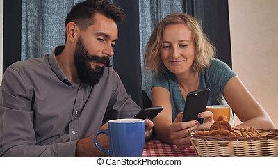 friends surfing internet on cellular.