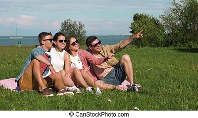 friends taking picture by selfie stick in summer -...