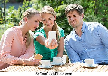 Friends Taking Selfie On Mobile Phone