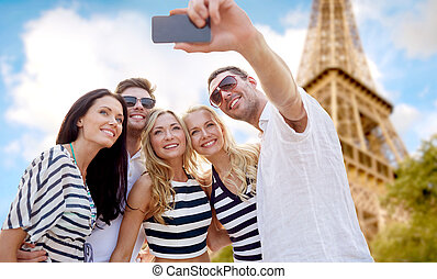 friends taking selfie with smartphone - summer, france,...