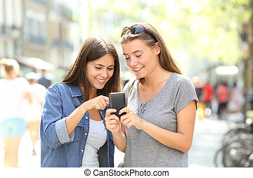 Friends talking about smart phone content