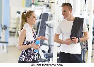 Friends talking at gym