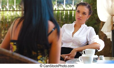 Friends Talking at Urban Cafe