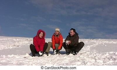 friends throw snow