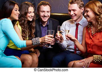 Friends toasting - Group of friends toasting with flutes of...