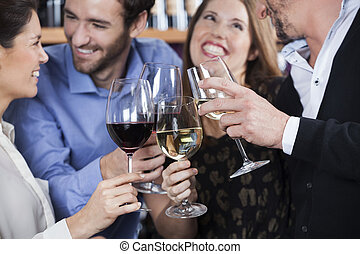 Friends Toasting Wine Glasses At Shop - Happy male and...