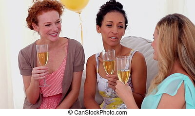 Friends toasting with champagne at