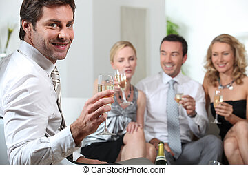 Friends toasting with champagne