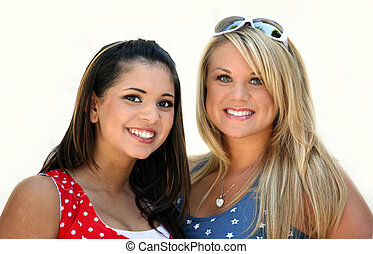 Friends - Two smiling girl friends - blond and brunette