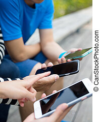 Friends using cellphone together
