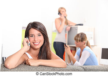 Friends using phones at home