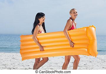 Friends walking on beach
