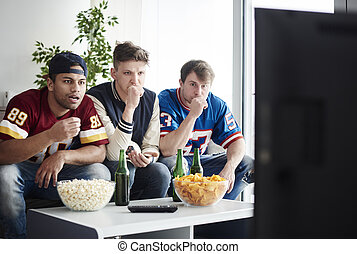 Friends watching sports on TV