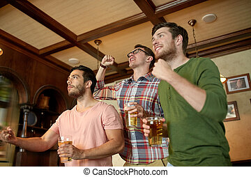 friends with beer watching sport at bar or pub - people,...