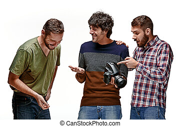 Friends with camera on white