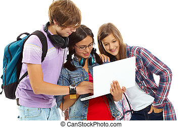 Friends with laptop - Three teenagers studying with laptop