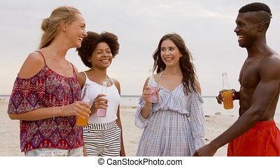 friends with non alcoholic drinks on beach - party, summer...