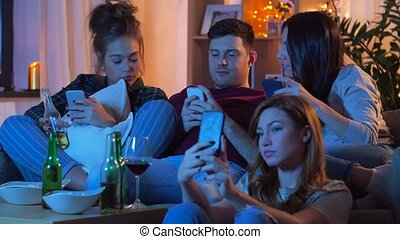 friends with smartphone watching tv at home - friendship,...