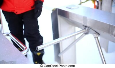 friends with snowboards go through Peak station entrance fee for ski lift. 1920x1080