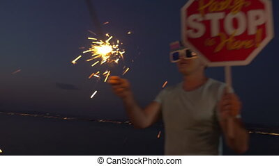 Friends with sparklers celebrating at the beach