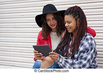 friends with the tablet on the street