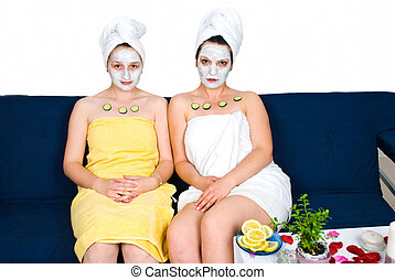 Friends  women with facial mask at spa resort