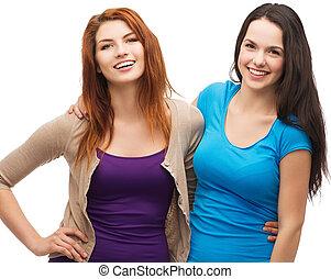 two laughing girls hugging
