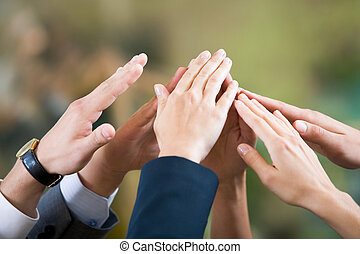 Friendship and support - Close-up of several human hands ...