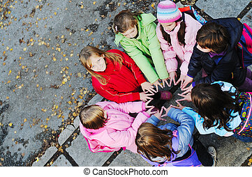 friendship and teamwork concept with young schoolgirls group...