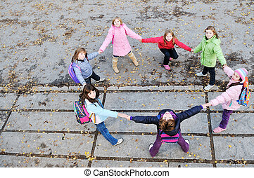 friendship and teamwork concept with young schoolgirls group