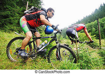 friendship and travel on mountain bike - two friends have ...