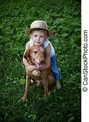 Friendship between child and dog