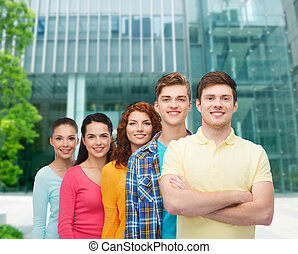 group of smiling teenagers over city background