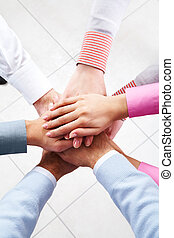 Friendship - Close-up of business people?s hands on top of...