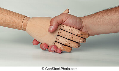 Wooden hand performing the greeting action with a hand of a person