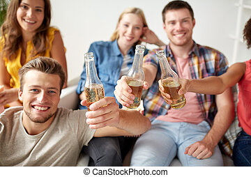 happy friends drinking beer at home party - friendship,...