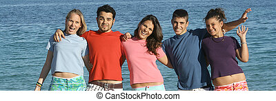 friendship group of teens, youth, kids or students at the beach,