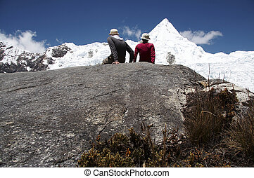 Friendship in the mountain - Girl and boy setting on the ...