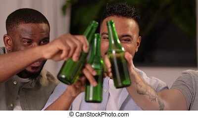 happy smiling male friends drinking beer at home