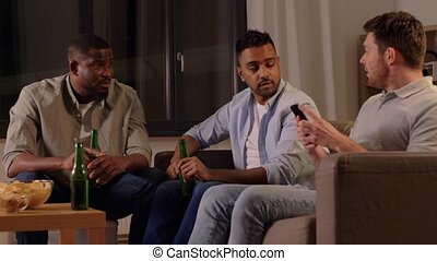 male friends drinking beer and talking at home