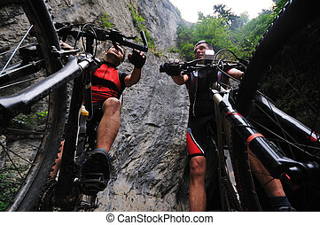 friendship outdoor on mountain bike - two friends have fun ...
