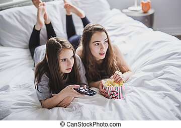 A pajama party, entertainment and junk food concept