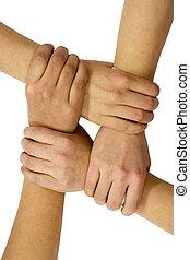 Friendship - Linked hands on a white background symbolizing...