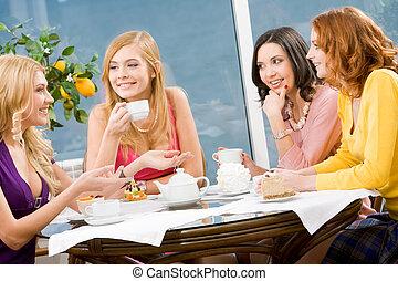 Friendship - Portrait of four attractive women having lunch...