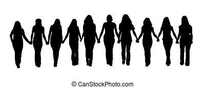 Friendship - Silhouette of ten young women, walking hand in...