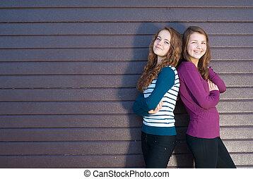 Friendship - Two best girlfriends against grey background