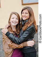 Friendship - Two best girlfriends hugging eachother