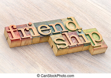 friendship word abstract in wood type