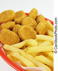 Basket of chicken nuggets with french fries.