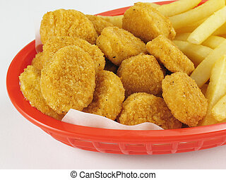 Fries & Nuggets - Basket of chicken nuggets with french ...